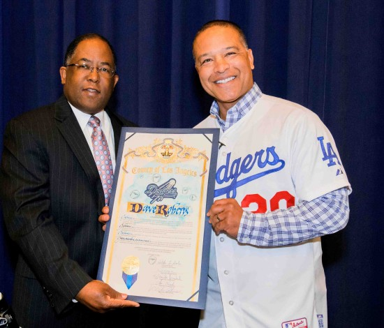 Dave Roberts receives a Board of Supervisors proclamation from Supervisor Mark Ridley-Thomas.