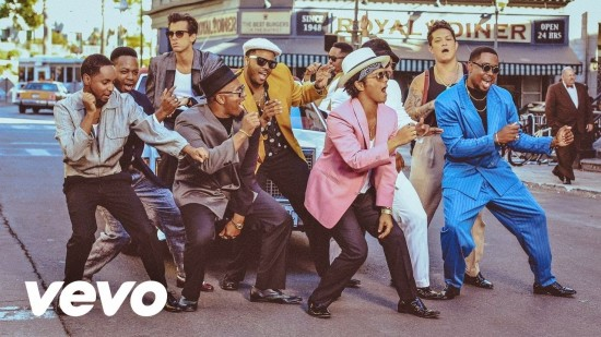 "Bruno Mars (out front in pink shirt) in ""Uptown Funk"" music video."