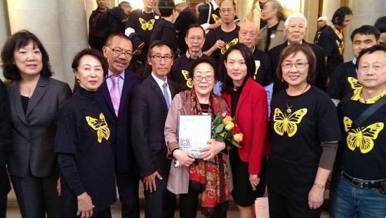 "(center), a surviving ""comfort woman,"" was welcomed by supporters at San Francisco City Hall last year. Pictured from left: Julie Soo, Judge Lillian Sing, Supervisor Norman Yee, Supervisor Eric Mar, Supervisor Jane Kim, Judge Julie Tang, and Ignatius Ding of the Global Alliance to Preserve the Truth of Sino-Japanese War."