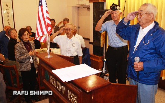 Frank Tanaka salutes as he leads the Japanese American Korean War Veterans in the Pledge of Allegiance at the organization's annual New Year and officer installation luncheon on Jan. 16 in Gardena.