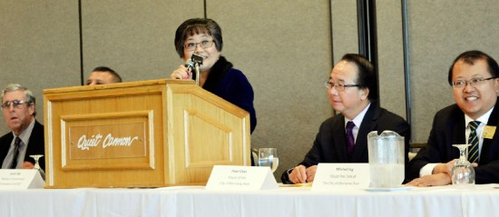 Janice Uba, president of the Monterey Park Japanese American Senior Citizens Club, addresses the gathering on Jan. 16. Dignitaries in attendance included (seated, from left) Monterey Park Mayor Peter Chan and Mitchell Ing, mayor pro tem.