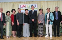 Members of L.A. Kayo Club with Seinan Senior Citizens Club President Yoshio Suzuki (left), Consul General Harry Horinouchi (center) and emcee Mika Matsui (right).