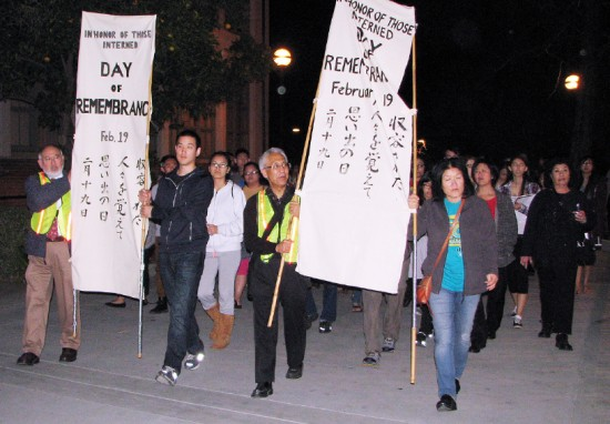 Members of Nihonmachi Outreach Committee and Silicon Valley JACL carried banners during a candlelight procession from on the SJSU campus.