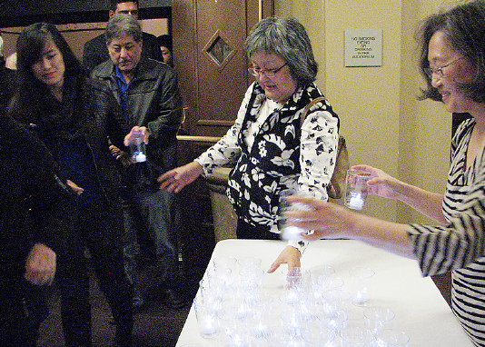 Attendees were given candles as they walked from Morris Dailey Auditorium to Yoshihiro Uchida Hall.