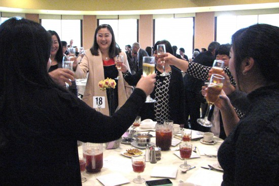 Attendees drink a toast to the Year of the Monkey.