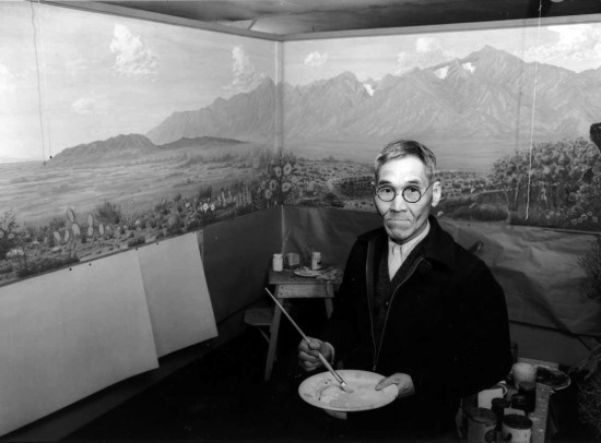 Tamekichi Carl Hibino painted the Owens Valley mural in 1943, while incarcerated in Manzanar. (Photo by Ansel Adams, courtesy Library of Congress)