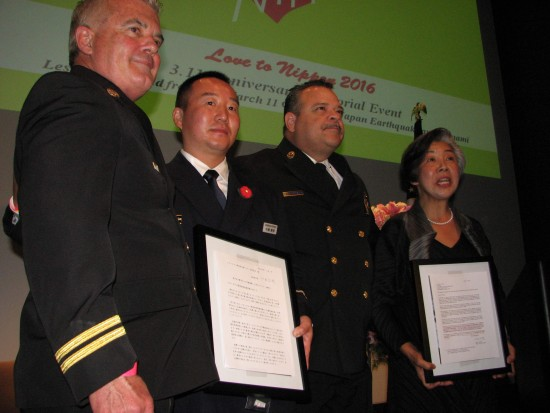 Yoshihiro Chiba (second from left) of the Ofunato Fire Department presented a letter from the mayor of Ofunato to Larry Collins (left) and Richardson of the L.A. County Fire Department. At right is Love to Nippon founder Masako Unoura-Tanaka.