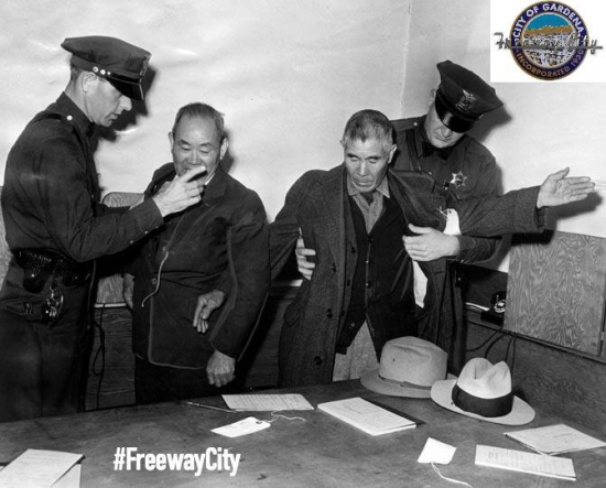 "Two Japanese American residents of Gardena being taken into custody in a giant roundup staged by federal agents after Pearl Harbor. (From ""Freeway City"")"