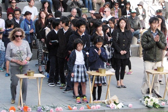 Participants of all ages offered incense and flowers during the interfaith service.