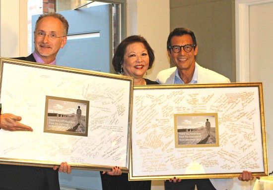 On behalf of the internees at Heart Mountain, Patti Hirahara recognized Jeff MacIntyre and David Ono in January at a special presentation in appreciation for the work they have done to tell the incarceration story.  (Photo by Tomomi Kanemaru)