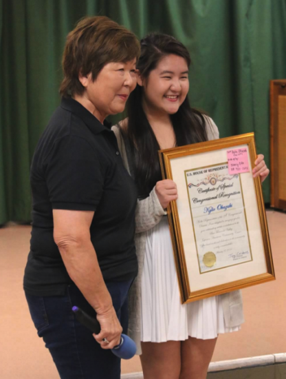 Nancy Oda of SFVJACC presented a congressional commendation to Kylie Okazaki, who designed the poster for JET.