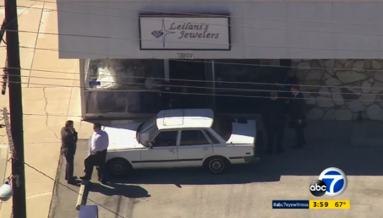 Investigators in front of Leilani's Jewelers in Torrance on Tuesday. (ABC7)