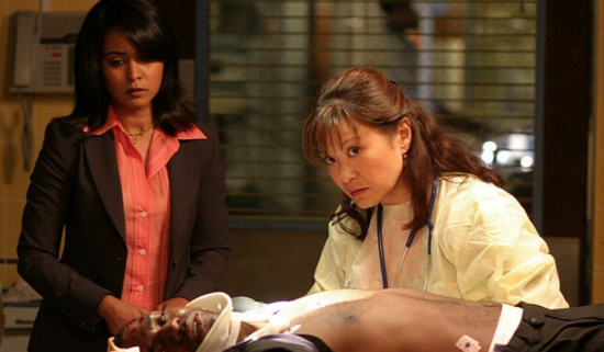 "On the set of ""ER"" (from left): Parminder Nagra, Mekhi Phifer (on gurney), Lily Mariye."