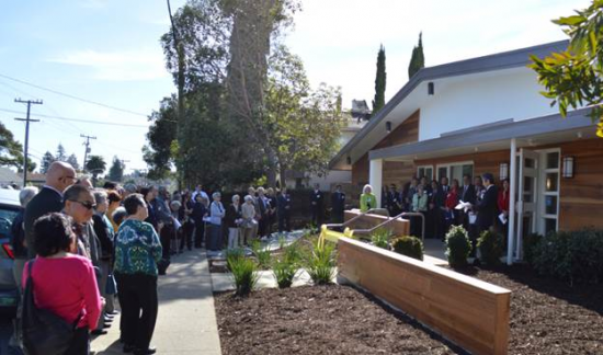 Kimochi San Mateo open house guests listening to Consul General Jun Yamada's opening remarks during the ribbon-cutting ceremony.