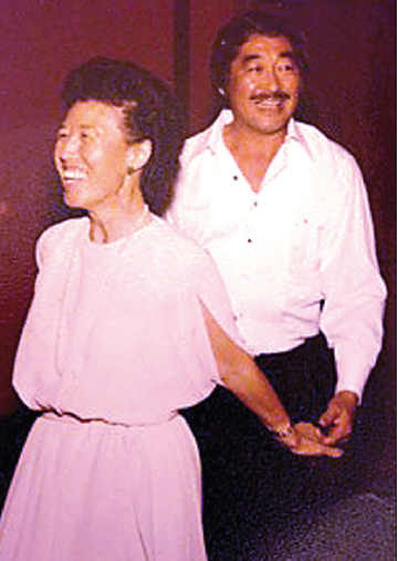 Mom and Dad, Sadae and Kuwa, dancing in the living room before going out. They met at The Rafu Shimpo.