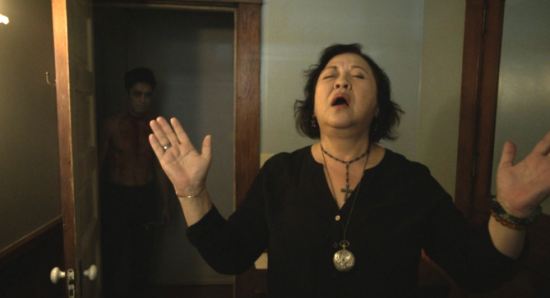 "Amy Hill in a scene from ""The Unbidden."""