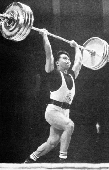 Tommy Kono performing the winning clean and jerk lift to become the World Middleweight Champion at the 1959 World Weightlifting Championships in Warsaw.