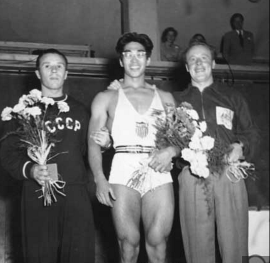 Tommy Kono (center), who won a gold medal as a lightweight at the 1952 Olympic Games in Helsinki, Finland, with silver medalist Yevgeni Lopatin of the U.S.S.R. (left) and bronze medalist Vern Barberis of Australia.