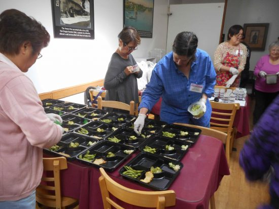 Members of Venice Honganji Buddhist Temple's Buddhist Women's Association prepare bentos at Hama Sushi.