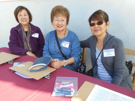 Volunteers June Tomita, Judy Nawa and Aya Masada.