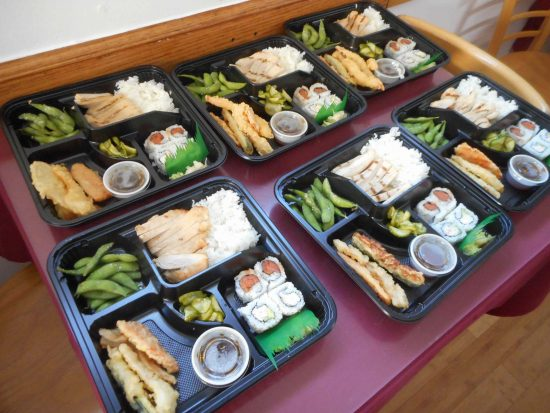 The bentos included sushi, chicken, tempura, and edamame.
