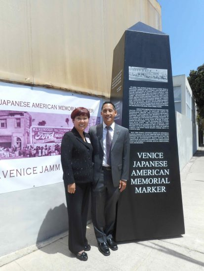 Esther Chaing of Hama Sushi and Len Nguyen of with a full-size model of the VJAMM obelisk.