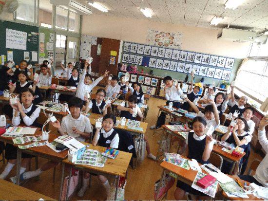 Students at Nobori-Cho Elementary School decorating paper crane boxes.