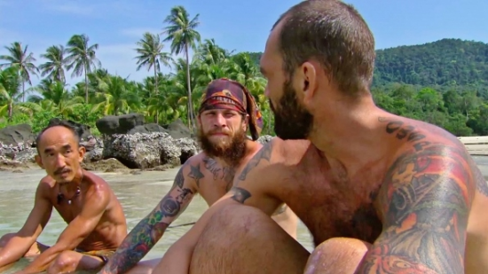 "Tai Trang plots strategy with Jason and Scot on ""Survivor."""