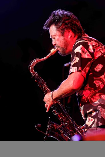 Dan Kuramoto on saxophone.