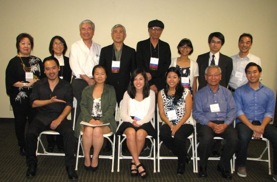 Front row, from left: Reader, judge and contest committee member Eijiro Ozaki; Japanese language winner Shirley Watanabe-Nishida; youth winner Sarena Kuhn; reader and committee member Alison Minami; committee chair Bill Watanabe; Colin Nozaki, representing Bunkado. Back row, from left: Emcee and committee member Miya Iwataki; Japanese language runner-up Takiko Morimoto; reader Darrell Kunitomi; Japanese language runner-up Akira Tsurukame; English language runner-up Ruben Guevara; youth runner-up Yuriko Chavez; Deputy Consul General Izuru Shimmura, judge; LTHS President Michael Okamura.