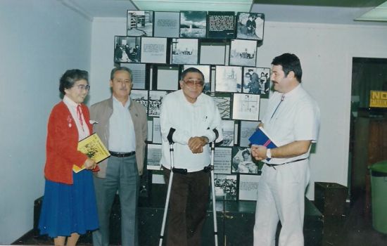 From right: Pierre Moulin with 442nd veteran Rudy Tokiwa, Serge Carlesso of Bruyeres, whose life was saved by 442nd medics, and educator/author Mary Tsukamoto in 1993.
