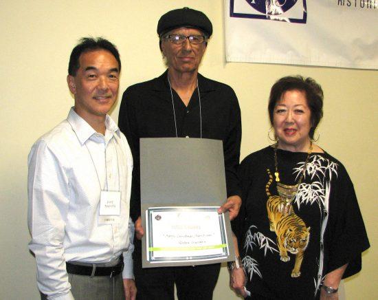 LTHS President Michael Okamura, English runner-up Ruben Guevara and emcee Miya Iwataki.