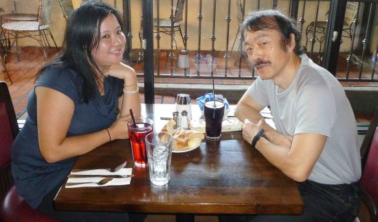 Erin Chew and Guy Aoki compare notes in Glendale.