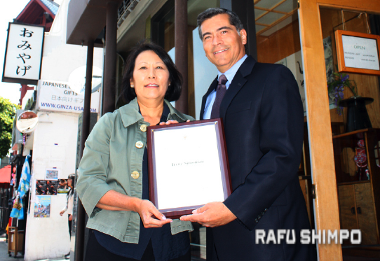 Irene Simonian, owner of Bunkado, is honored by Rep. Becerra. (GWEN MURANAKA/Rafu Shimpo)