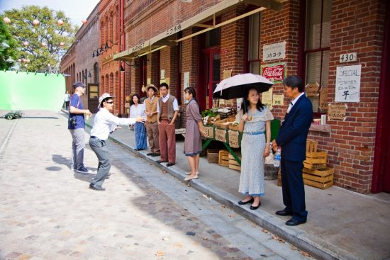 Director Jeffrey Gee Chin sets up a 1930s street scene.