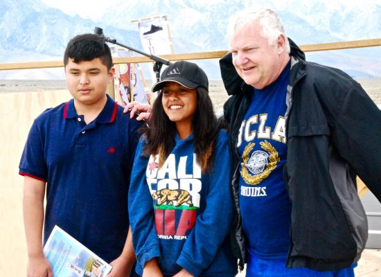 Seventh-graders Juan Carlos Constantino (left) and Karina Ventura (center), winners of the Manzanar Committee's 2016 Student Awards Program, with teacher Darrell Warren at the 47th annual Manzanar Pilgrimage on April 30. (Photo by Gann Matsuda/Manzanar Committee)