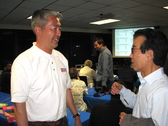 Candidate Al Muratsuchi chats with supporter Chogi Higa on election night in Torrance. (J.K. YAMAMOTO/Rafu Shimpo)