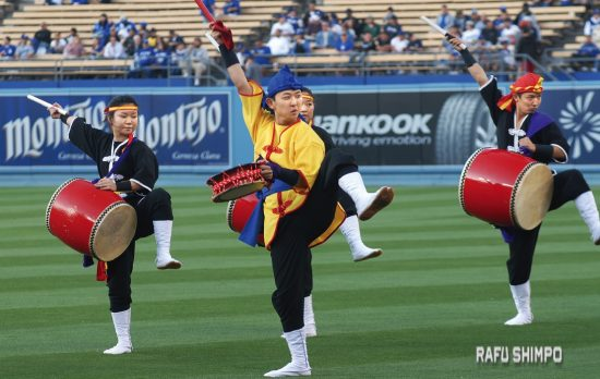 Okinawan drumming troupe Ryukyukoku Matsuri Daiko performs ahead of the game at Dodger Stadium.