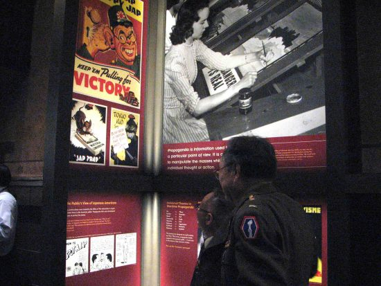 The exhibition included anti-Japanese propaganda posters that reinforced racial stereotypes.