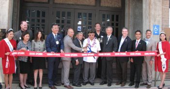 Taking part in the ribbon-cutting were (from left): Nisei Week Princess Tamara Teragawa; Vince Beresford, GFBNEC president/CEO; Irene Hirano Inouye, U.S.-Japan Council; Linda Lopez, Mayor's Office of Immigration Affairs; Rep. Mark Takano; Bill Seki, GFBNEC chairman; former Secretary of Transportation Norman Mineta; MIS veteran Ken Akune; Chip Mamiya, GFBNEC Board of Governors; Consul General Harry Horinouchi; Assemblymember David Hadley; West Covina Mayor James Toma; JANM President/CEO Greg Kimura; Nisei Week  Princess Camryn Sugita.
