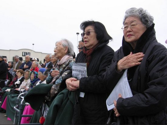"""Tomoye Takahashi (right) and her sister, Martha Suzuki, at a Tanforan commemoration in 2007, held at the site of the wartime """"assembly center,"""" formerly a race track and now a shopping mall. (Hokubei Mainichi)"""