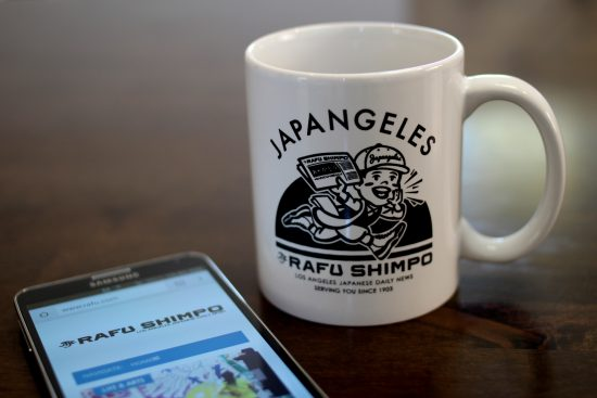 A paperboy delivers the news in a limited edition mug created by Japangeles in partnership with The Rafu Shimpo.