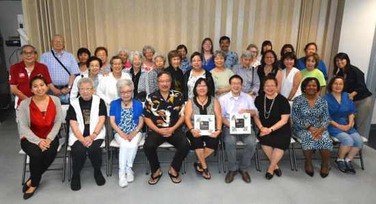 AARP AAPI Hero Award winner Julie Kimiyo Hubbard (front row, center) with Yu-Ai Kai Executive Director Ryan Kawamoto, Daphne Kwok and Edna Kane-Williams of AARP, and Yu-Ai Kai seniors and staff.