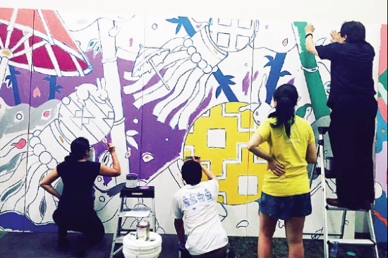 Volunteers work on a Tanabata-themed portion of a mural that will be unveiled on July 9.