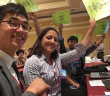 Sheldon Arakaki and Sarah Baker of Seattle JACL cast their votes for the emergency resolution.  (Photo by Stanley M. Shikuma)