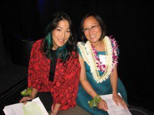 Emcee traci kato-kiriyama and JACCC President and CEO Leslie Ito.