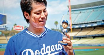 Kenta Maeda is amused by his tiny likeness, the Maeda bobblehead doll that will be given to the first 40,000 in attendance at next Tuesday's Japan Night and ballgame at Dodger Stadium. (Photo courtesy L.A. Dodgers)