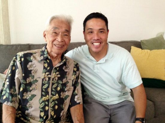 """Tommy Kono and """"Arnold Knows Me: The Tommy Kono Story"""" filmmaker Ryan Yamamoto pose for a picture at Kono's home in Hawaii on Sept. 30, 2015. (Courtesy Ryan Yamamoto)"""