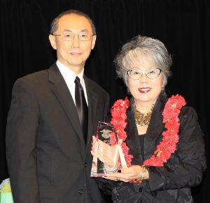 Outgoing National JACL President David Lin with JA of the Biennium honoree Carole Hayashino, president and executive director of the Japanese Cultural Center of Hawaii. (Photo by Thomas Nishikawa)
