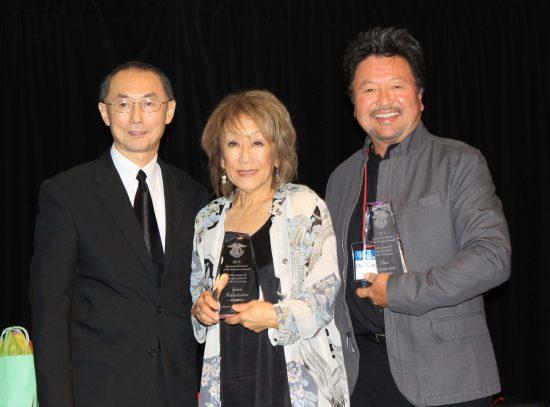 Outgoing National JACL President David Lin with JA of the Biennium honorees June Kuramoto and Dan Kuramoto, founders of Hiroshima. (Photo by Thomas Nishikawa)